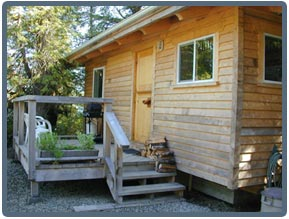 The Cypress Cabin: Featuring a fully equipped kitchen, sleeping loft, master bedroom, wood stove and private bathroom to ensure your stay is pleasant and comfortable. The Cypress cabin can sleep up to seven with the provided cot.