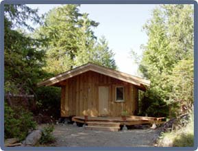 The Fir Cabin: Beautiful post and beam construction. This intimate cabin has a fully equipped kitchen, master bedroom, pullout couch, wood stove and private bathroom with shower.  Perfect for a couple (or two) or a small family.